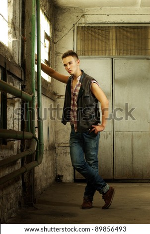 Fashion style photo of an attractive young man - stock photo