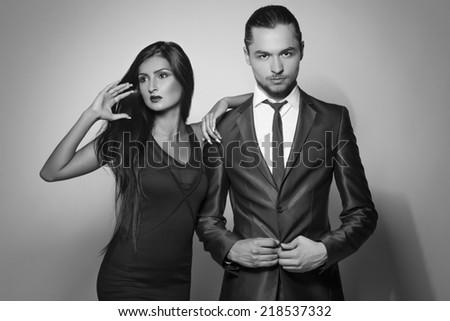 Fashion style photo of beautiful couple, studio shoot - stock photo