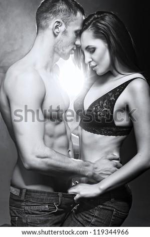 Fashion style photo of sexy couple - stock photo