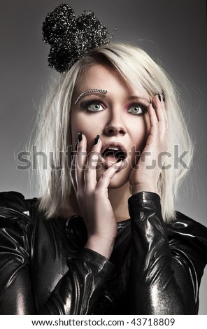 Fashion style portrait of a scared young lady - stock photo