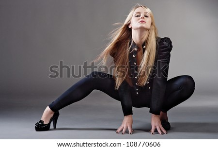 Fashion style portrait of young woman - stock photo