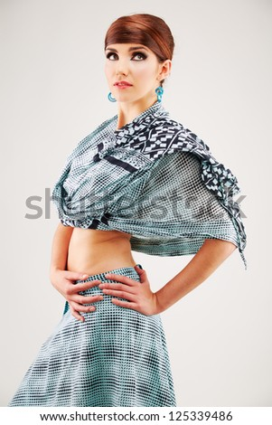 Fashion style woman portrait in asian clothes isolated over white background.