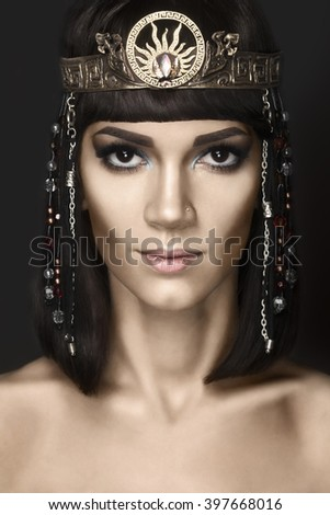 Fashion Stylish Beauty Portrait with Black Short Hair. Beautiful Girl's Face Close-up. Haircut. Hairstyle. Fringe. Professional Makeup. Make-up. Cleopatra - stock photo