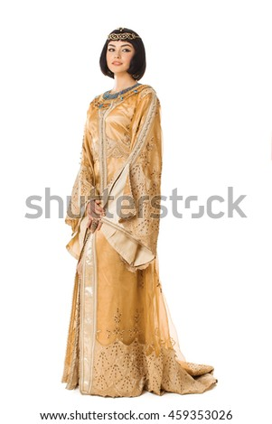 Fashion stylish beauty woman with black short haircut and professional make-up and golden dress of Cleopatra. Beautiful girl's in full lenght on white isolated background - stock photo