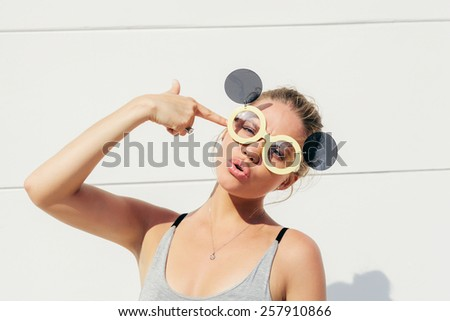 Fashion summer portrait of pretty young sensual blonde woman in sunglasses posing - stock photo