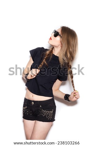 Fashion swag girl  with two long braids in sunglasses.  White background, not isolated - stock photo