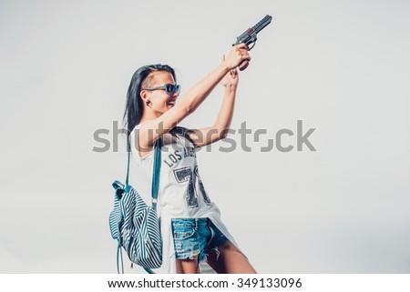 Fashion swag sexy girl holding gun woman having fun  hooligan, rebel - stock photo