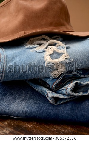 Fashion Torn Jeans and Leather Hat - stock photo