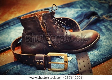 Fashion trend - jeans, leather shoes, leather belt with buckle - stock photo