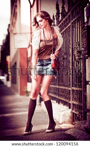 fashion urban portrait of beautiful model on the street.High fashion urban portrait of young, slim, beautiful model. - stock photo