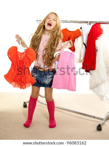 fashion victim kid girl at backstage wardrobe choosing clothes - stock photo