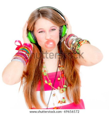 Fashion victim listening to music and blowing a bubble with gum - stock photo