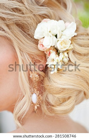 fashion wedding hairstyle  with flowers - stock photo