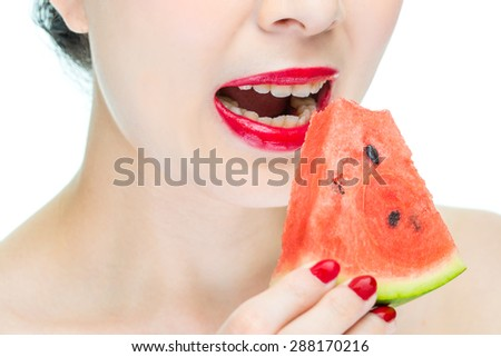 Fashion woman enjoy eating watermelon with red lips, sexy