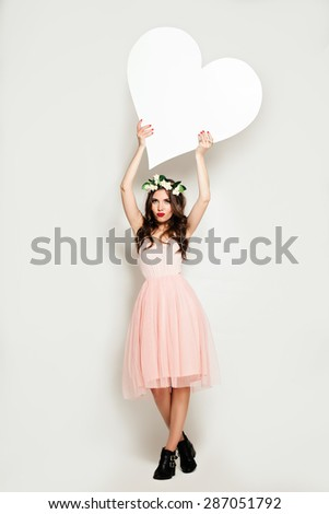 Fashion Woman holding Big White Heart Banner. Sale Background  - stock photo