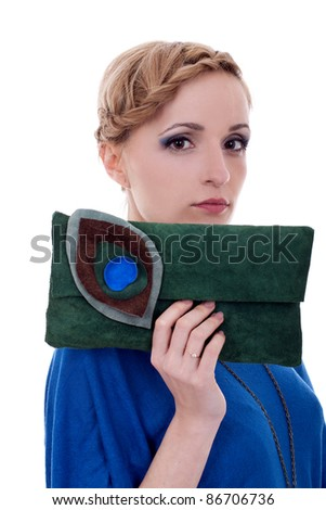 fashion woman holding little purse for everyone to see - stock photo