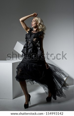 Fashion woman in black dress - stock photo