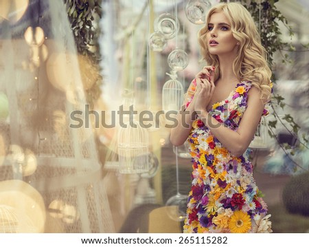 Fashion woman in dress of flowers - stock photo