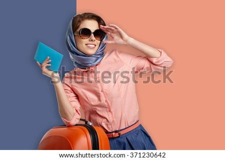 Fashion woman in sunglasses and scarf. studio shot - stock photo