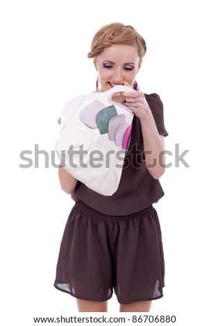 fashion woman looking into her purse with amazement, over white - stock photo