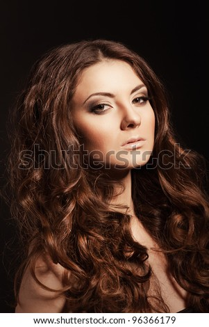 Fashion woman model with glitter evening make-up. Girl with long curly hairs. - stock photo