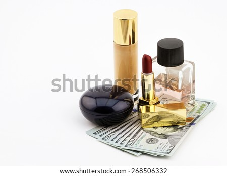 Fashion woman objects. Cosmetic set with fan of one hundred dollar bills on white background - stock photo