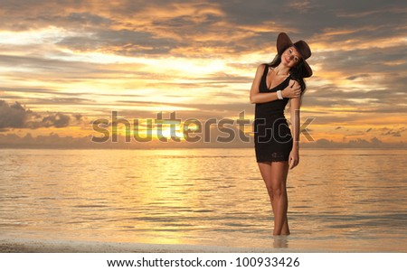 Fashion woman on the sea sunset background