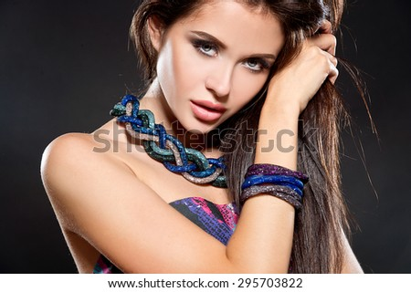Fashion woman portrait. Beautiful woman with bright necklace and bracelet - stock photo