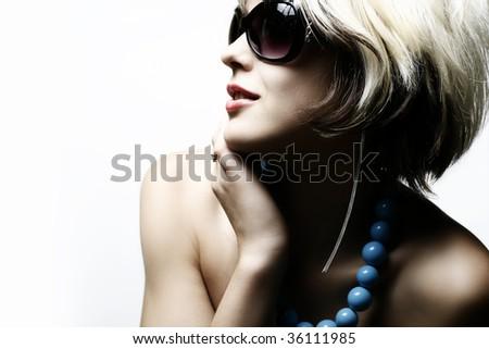 Fashion woman portrait wearing sunglasses on white background - stock photo
