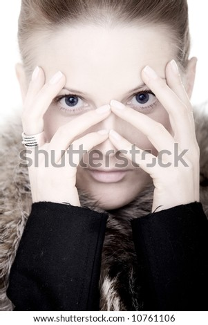 fashion woman portrait with her hands on her face over a white background - stock photo