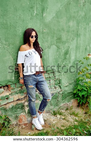 Fashion woman posing outdoor - full length portrait