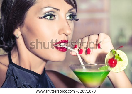 Fashion woman retro portrait with a cocktail - stock photo