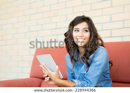 Fashion woman using tablet with lens flare - stock photo