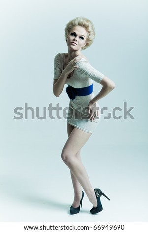 Fashion woman with a sly glance - stock photo