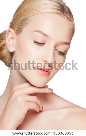 Fashion woman with beautiful face - isolated on white. Skin care concept. - stock photo