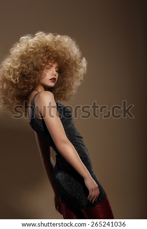 Fashion Woman with Fancy Hairstyle. Haute Couture - stock photo