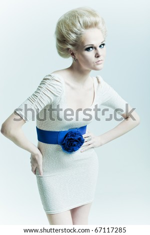 Fashion woman with hands on belt - stock photo