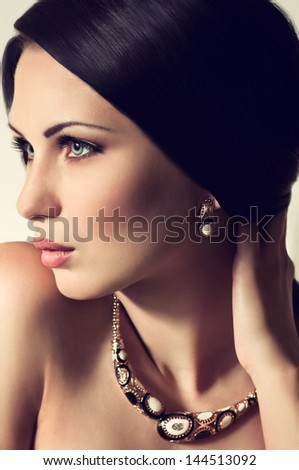 Fashion woman with jewelry decoration. Fashion portrait - stock photo