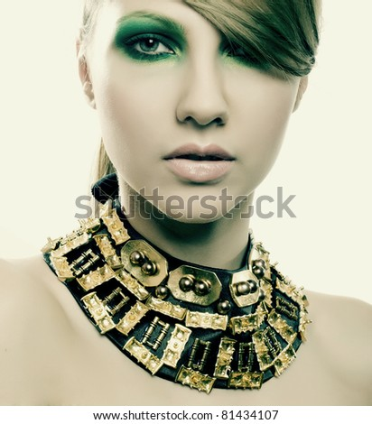 fashion woman with jewelry on light background with pearls - stock photo