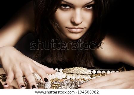Fashion woman with jewelry precious decorations. - stock photo