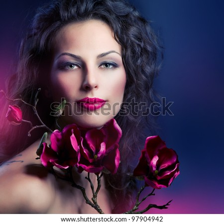 Fashion Woman With Magnolia Spring Flowers - stock photo