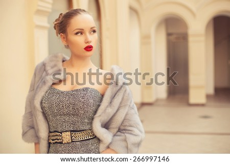fashion woman with red lips walking in the city - stock photo