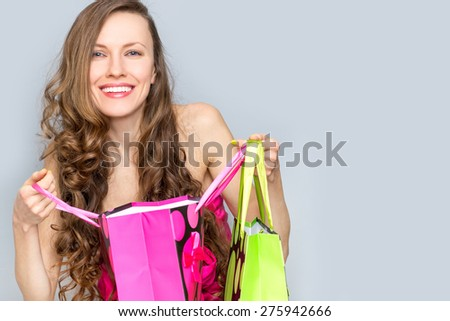 Fashion woman with shopping bags excited - stock photo