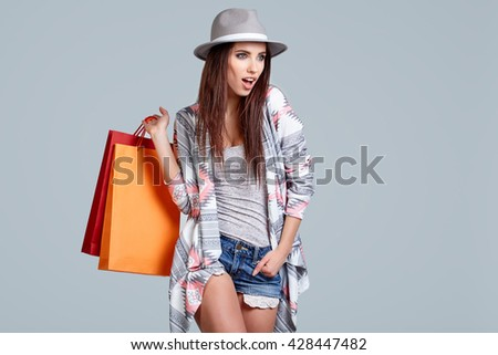 Fashion woman with shopping bags. Studio shoot - stock photo