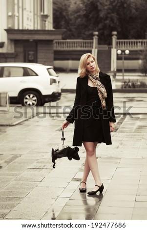 Fashion woman with umbrella in the rain  - stock photo
