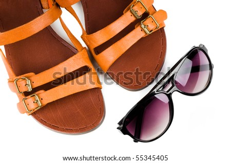 Fashion women sandals and sun glasses isolated on white - stock photo