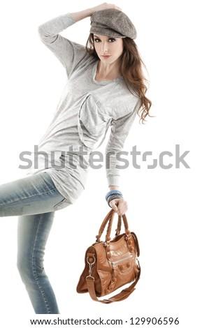 fashion women wearing sunglasses with bag posing shot in studio - stock photo