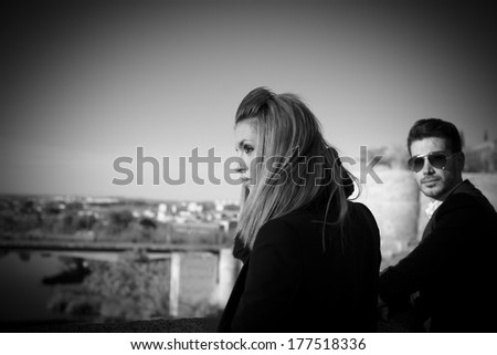 Fashion young couple in black and white in Toledo, Spain - stock photo