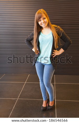 fashion young handsome woman against indoor boutique - stock photo