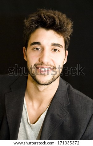 Fashion young man with jacket over black background
